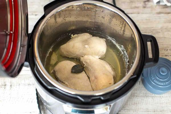 Three cooked chicken breasts in the instant pot