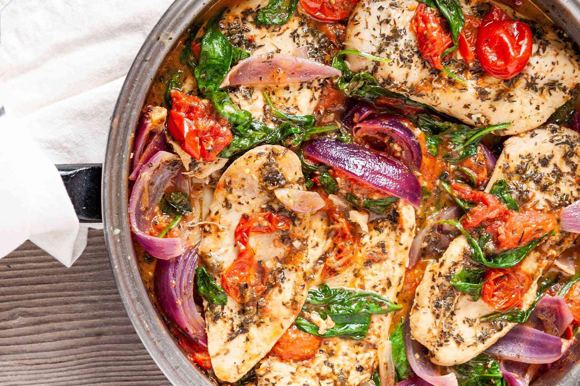 skillet chicken with onions tomatoes and herbs