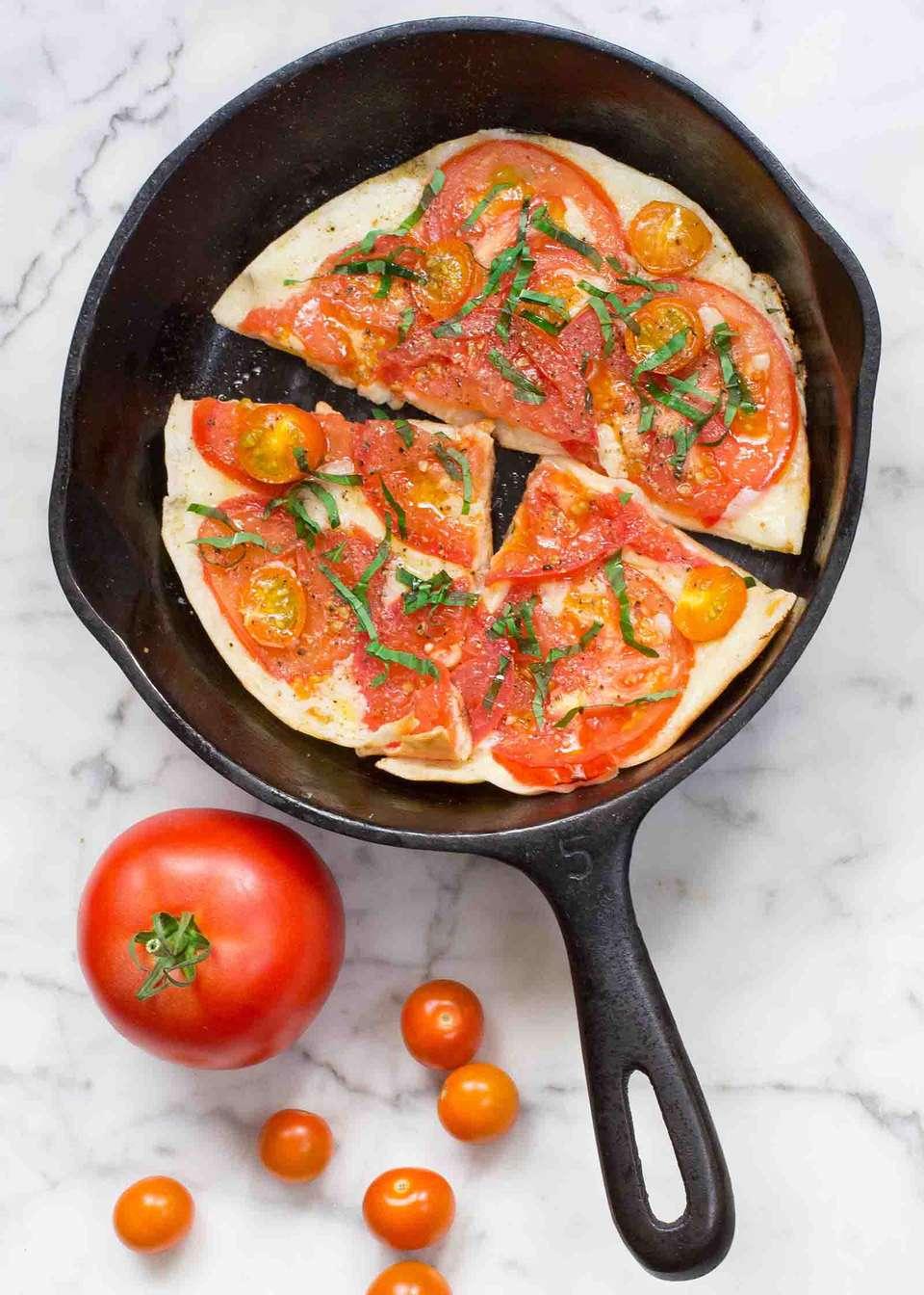 Tomato and Mozzarella Skillet Pita Pizzas