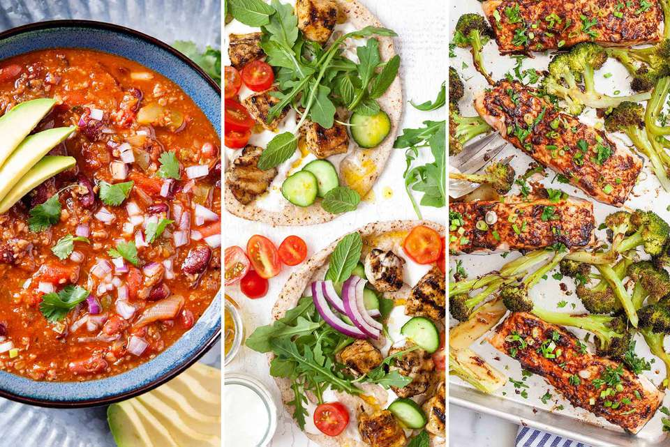 A picture of three recipes side by side. To the left is a blue bowl of healthy vegetarian chili, in the middle is greek chicken skewers on pita bread with sliced cucumber, halved grape tomatoes and red onion slices. To the right is immune boosting salmon fillets baked on a sheet pan with broccoli florets and topped with sliced scallions.