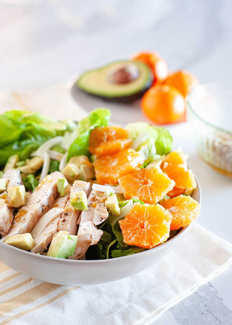 winter asian chopped chicken salad with mandarins and avocado