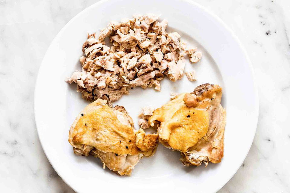 Small bits of cooked chicken removed from bone and without skin
