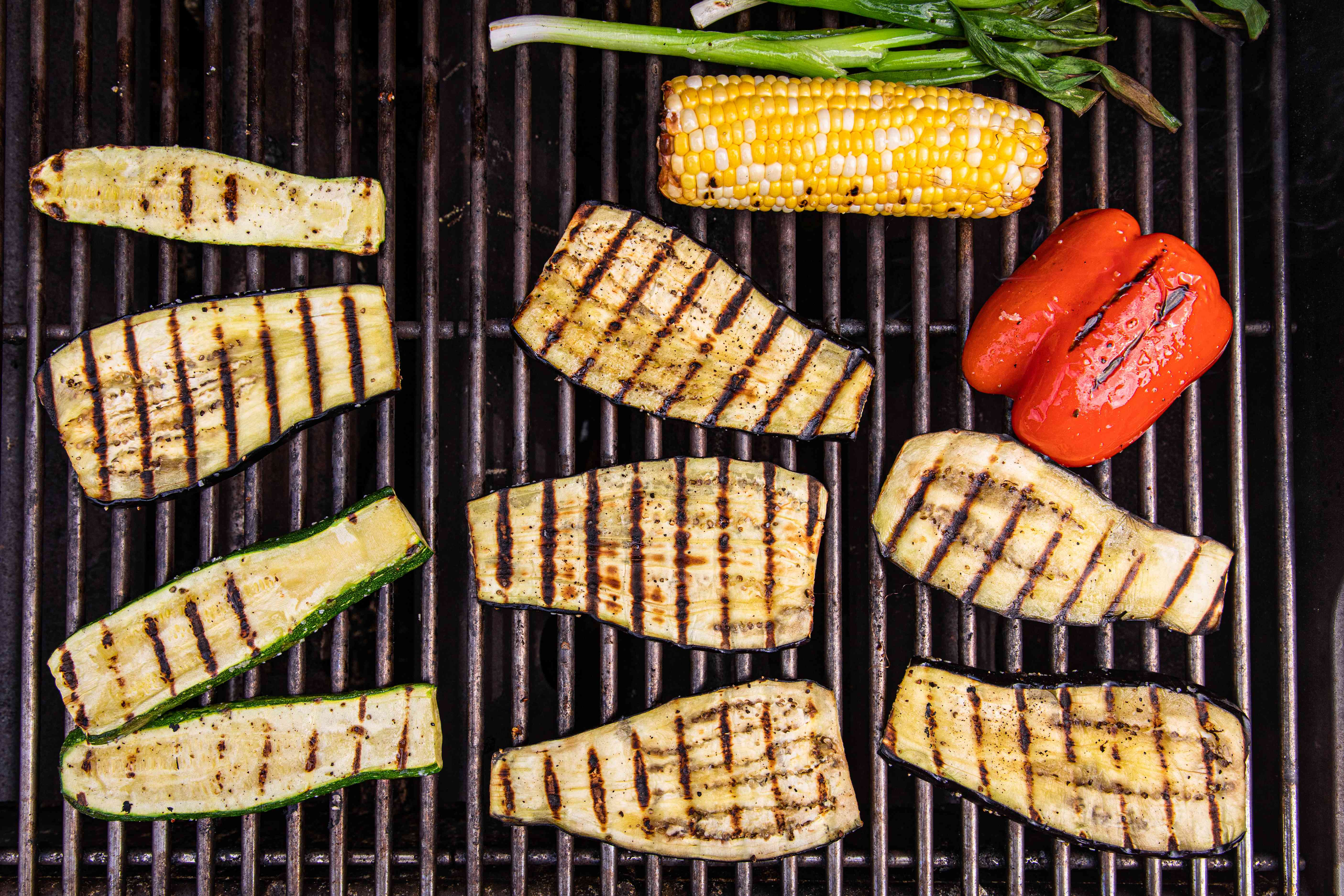 Grilling zucchini, peppers, and corn to make easy grilled vegetable nachos.
