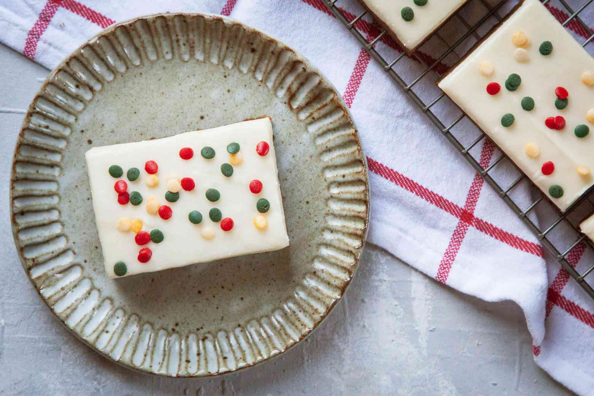Overhead view of the Best Gingerbread Bars on a plate and topped with sprinkles and frosting.