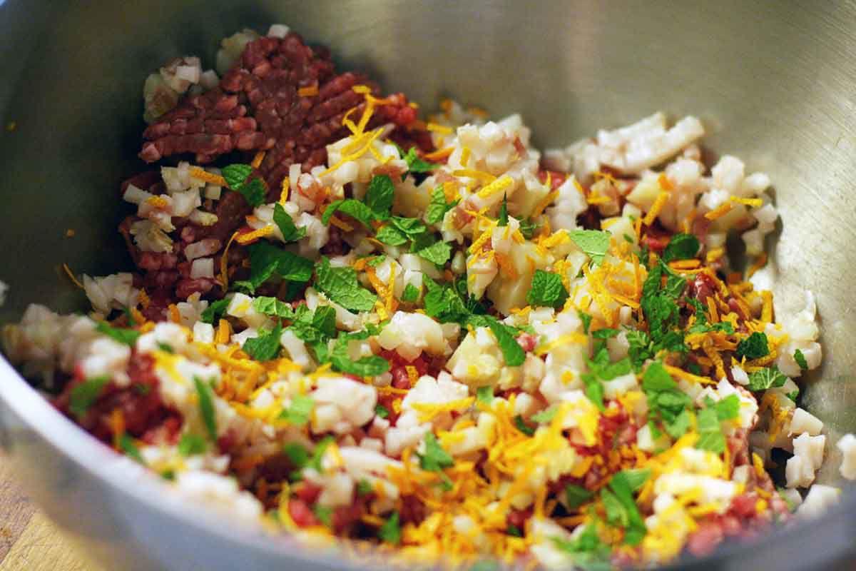 greek meatball ingredients in large mixing bowl