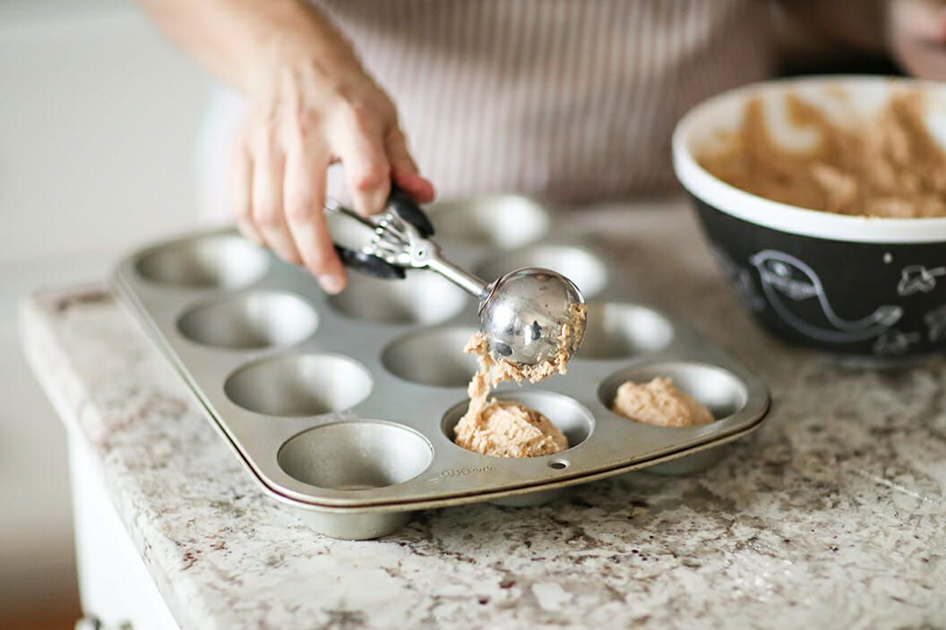 Whole Wheat Nut Muffins fill the muffin cups