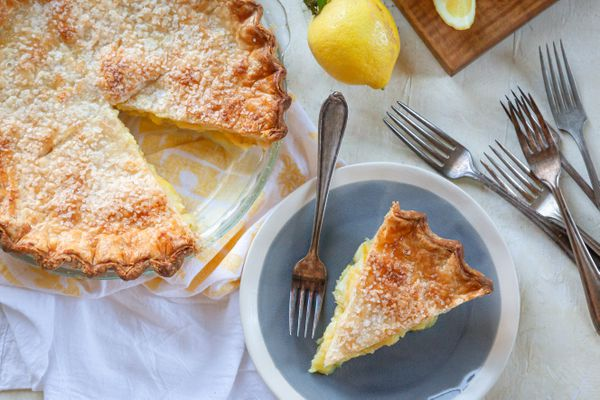 6 Ingredient Lemon Pie with a slice on a plate.