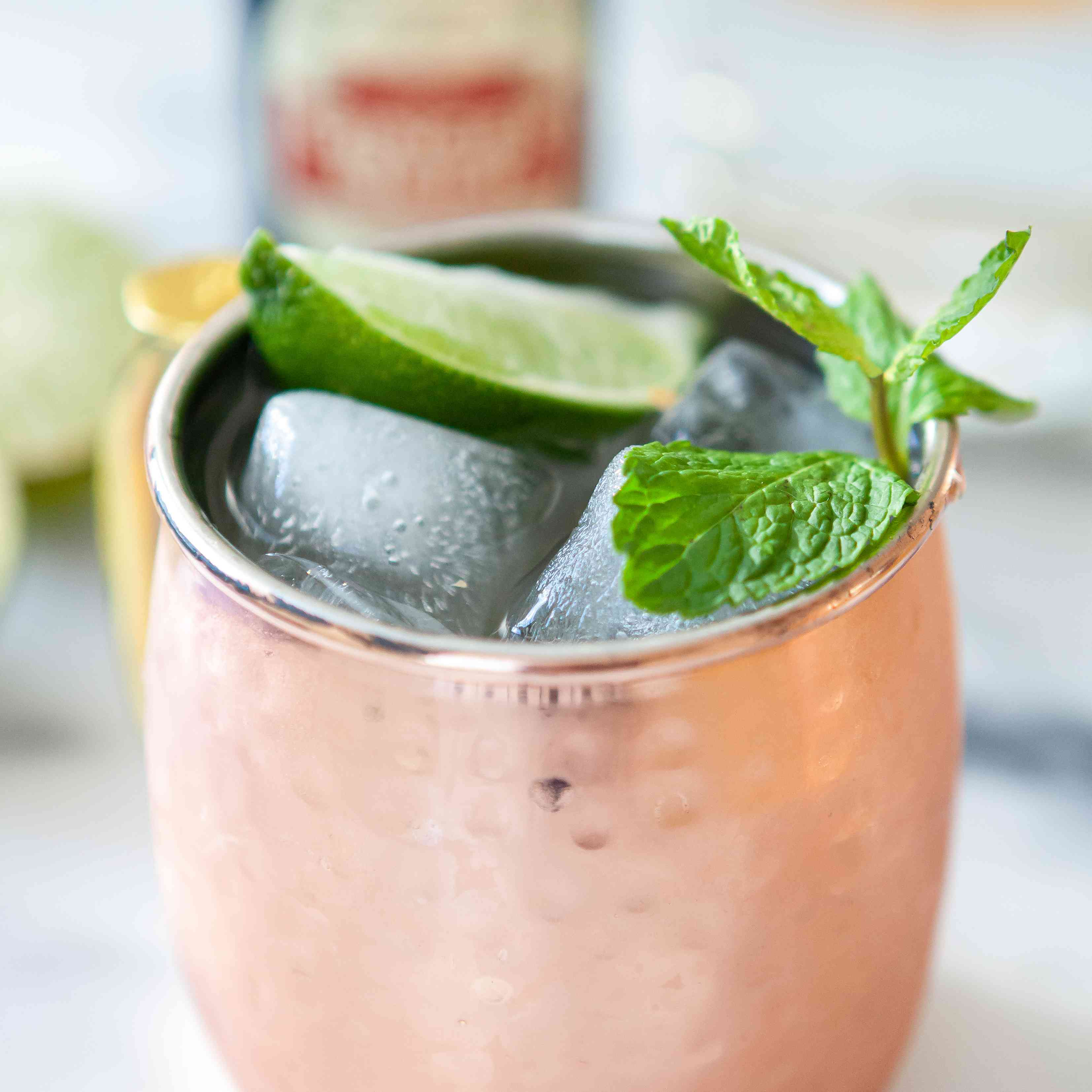 A Classic Moscow Mule garnished with lime and mint.