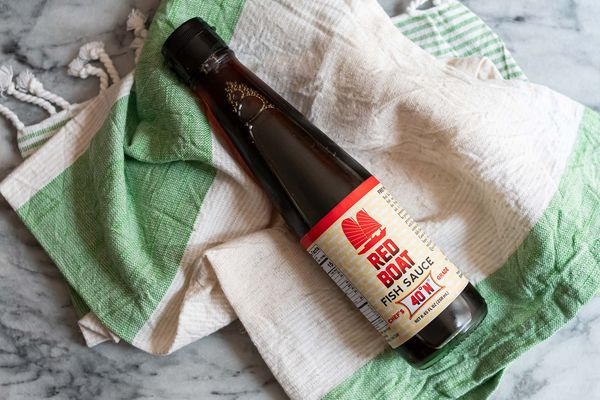 Red Boat Fish Sauce laid on a towel.