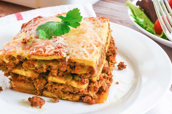 A slice of Pastelon Puerto Rican Plantain Lasagna on a plate